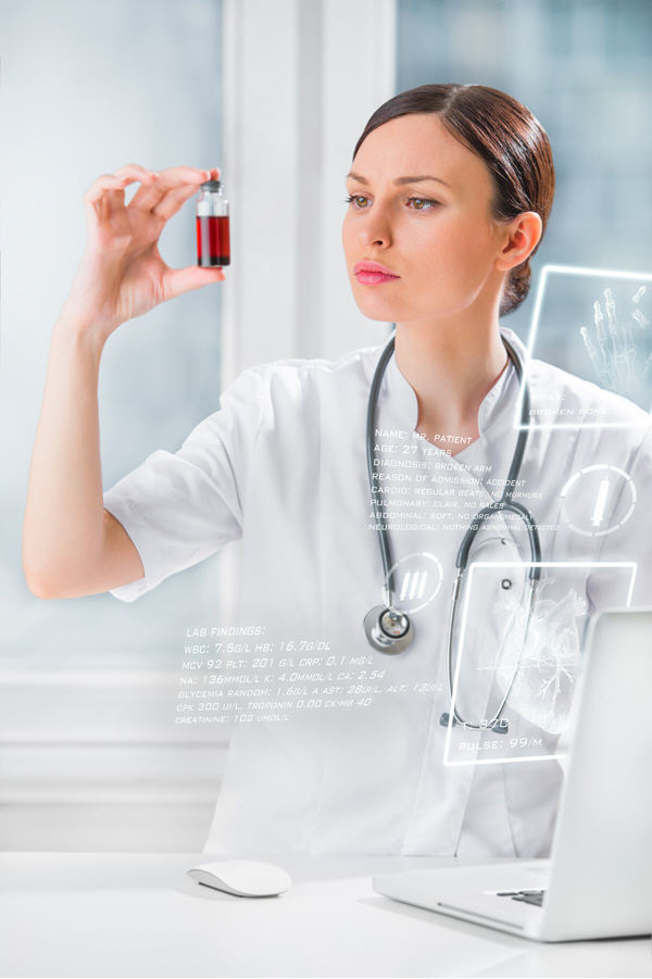 portrait of pretty female laboratory assistant analyzing a blood sample