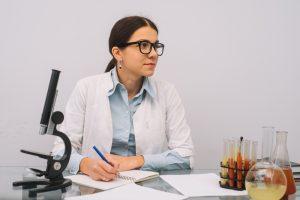 medical doctor sitting at desk 300x200