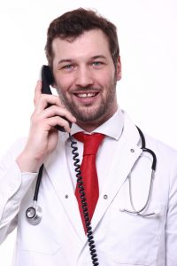 Happy HGH doctor talking on phone 200x300