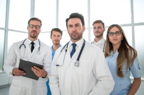 group of doctors staring at the camera e1556710184433